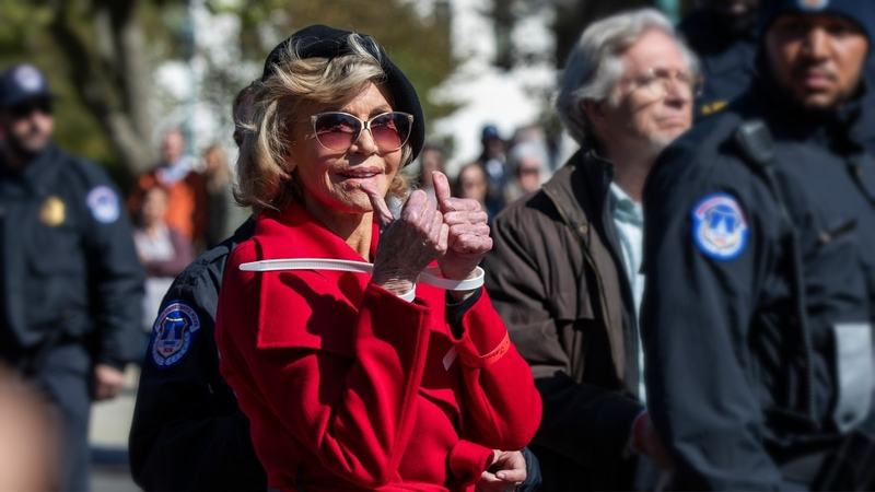 Actress Jane Fonda gestures after being arrested during a rally on Capitol Hill in Washington, Friday, Oct. 18, 2019. A half-century after throwing her attention-getting celebrity status into Vietnam War protests, Fonda is now doing the same in a U.S. climate movement where the average age is 18. (AP Photo/Manuel Balce Ceneta) — Copyright 2019 The Associated Press. All rights reserved.