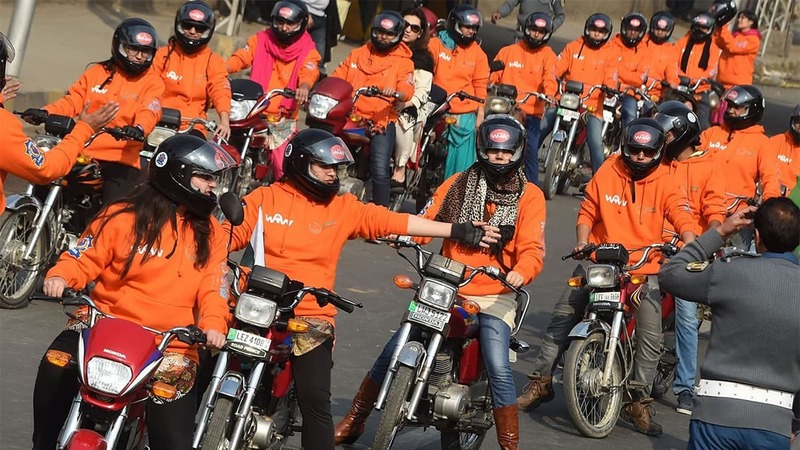 Women participants of Women on Wheels (WOW) wait on their motor-bikes prior to the start of a rally launching the Women on Wheels campaign in Lahore on January 10, 2016. — AFP/File