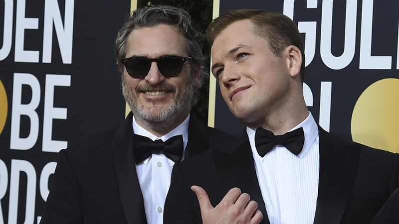 Joaquin Phoenix, left, and Taron Egerton arrive at the 77th annual Golden Globe Awards at the Beverly Hilton Hotel on Sunday.—AP