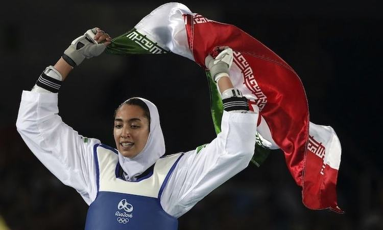 Kimia Alizadeh of Iran celebrates after winning the bronze medal in a women's Taekwondo 57-kg competition at the 2016 Summer Olympics in Rio de Janeiro, Brazil.