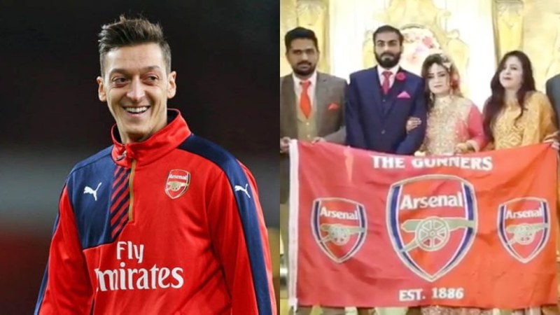 He shared a video of the couple who can be seen holding an Arsenal flag and making Ozil's infamous M hand sign