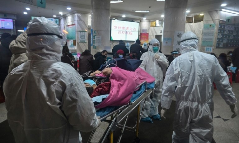 Chinese premier visits virus epicenter as death toll hits 80