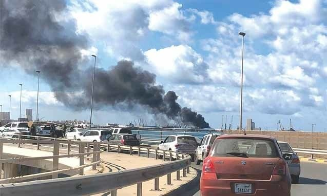 Rebels pound port in Libyan capital with rocket fire