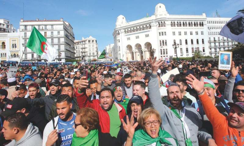 Algerians flood streets to mark movement's first birthday