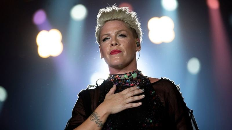 The singer said she and her three-year-old son were displaying symptoms two weeks ago and she tested positive.