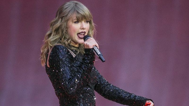 "In this June 22, 2018, file photo, singer Taylor Swift performs on stage in concert at Wembley Stadium in London. Swift is canceling all of her performances and appearances for the rest of the year because of the coronavirus pandemic. ""With many events throughout the world already cancelled, and upon direction from health officials in an effort to keep fans safe and help prevent the spread of COVID-19, sadly the decision has been made to cancel all Taylor Swift live appearances and performances this year,"" Swift's representative said in a statement released Friday. (Photo by Joel C Ryan/Invisi"