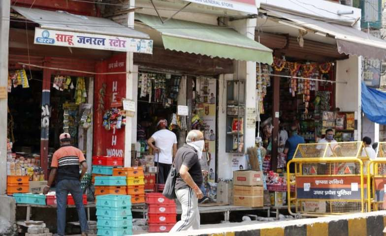 India opens few stores as virus restrictions ease in some countries