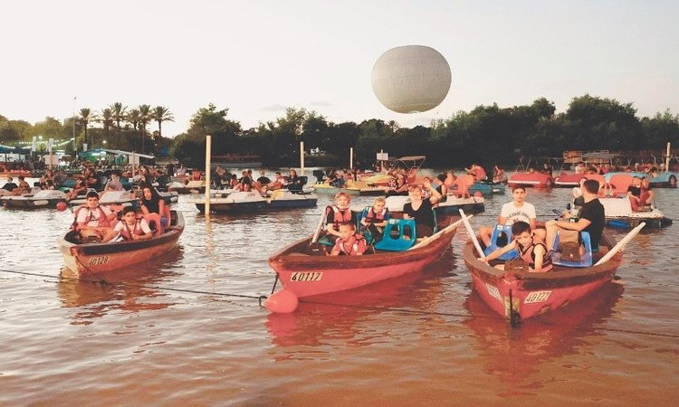 Israelis watch a movie  while sitting in distanced pedal boats at the sail-in