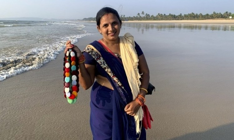Seema Rajgarh, 37, hawks jewellery made of beads and stones on nearly deserted Utorda beach in South Goa, India.