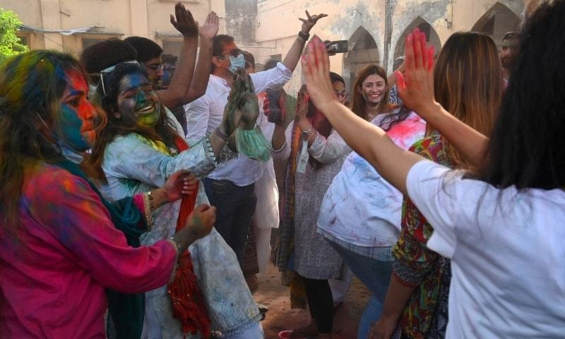 In pictures: Plenty of colour but no masks during Holi celebrations in South Asia