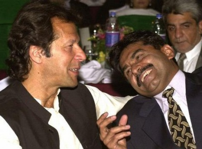 Miandad and Khan share a joke during a fundraiser in 2004. Khan retired from cricket in 1992 and Miandad in 1996.