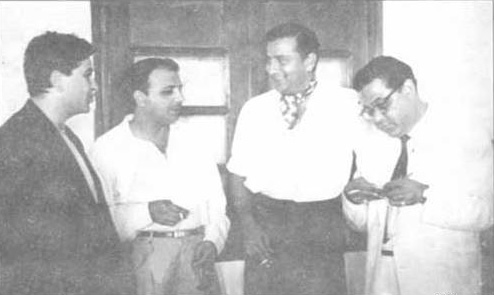Fazal (third from left) enjoying a smoke and a chat with famous Indian film star, Raj Kapoor (first from left) at a party in Mumbai, India.