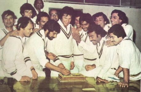 Pakistan team celebrates Imran Khan's birthday in the dressing room during Pakistan's 1979 tour of India. From Left (back row): Abdur Raqeeb, Sikander Bakht, Sadiq Mohammad, Taslim Arif, Unknown Official, Asif Iqbal, Abdul Qadir, Zaheer Abbas. From Right (front row): Talat Mirza, Mudassar Nazar, Javed Miandad, Imran Khan, Wasim Raja and Naeem Ahmed.