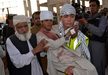 A boy who was injured in a bomb blast is carried by his relatives as they move to another hospital in Quetta June 15, 2013. — Reuters Photo.