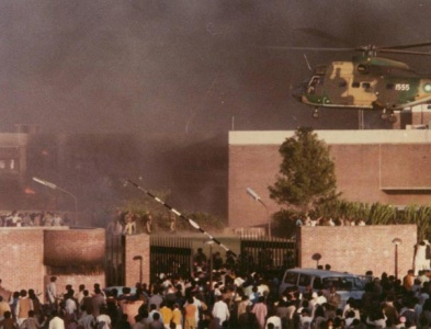A Pakistan Army helicopter hovers over the burning US embassy in Islamabad, 1979.