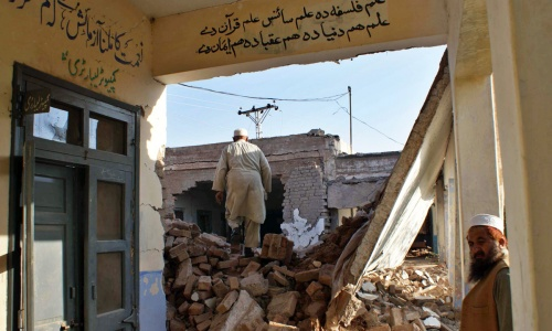 Men inspect the damage to a school building in Bara, Khyber region, in this November 2009 file photo. -Photo by AFP