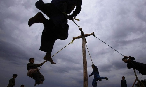 Afghan refugee boys play on a homemade swing on the outskirts of Islamabad, Pakistan. -Photo by AP