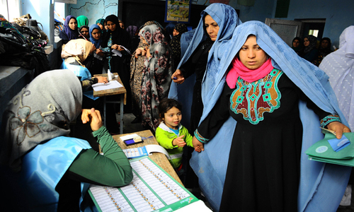 Afghans defy Taliban threat, vote in big numbers