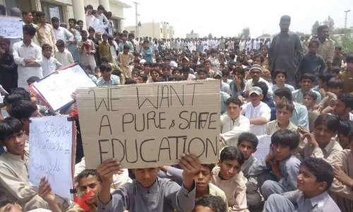 Parents, students and residents of Panjgur protest against threats to schools. — Photo by author.