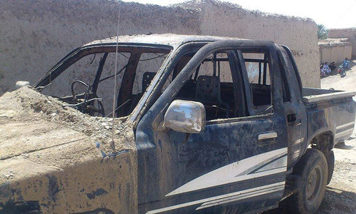 Unidentified gunmen set a school van, transporting female students and teachers, on fire on 14 May 2014. — File photo by author