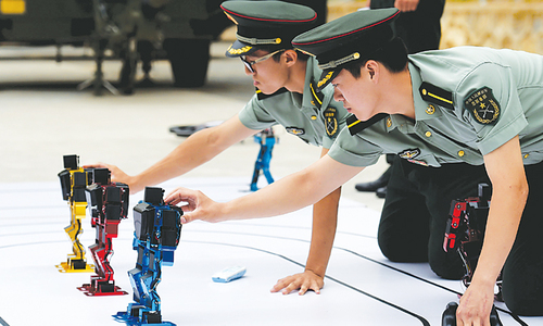 Chinese army shows off dancing robots
