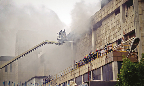 People suffer as firefighters struggle to put out factory blaze