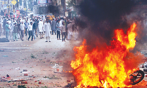Delhi sends paramilitary men to UP town after communal riots