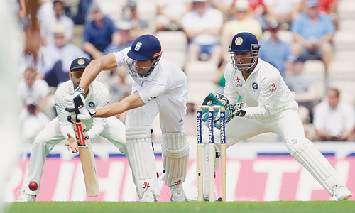 Cook closes in on elusive century as India toil