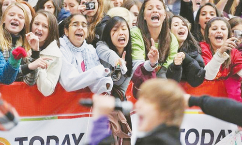 Beatlemaniacs, Beliebers, Directioners — why do they scream?