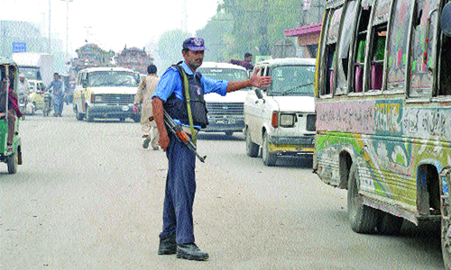 Targeted attacks force traffic police to carry arms
