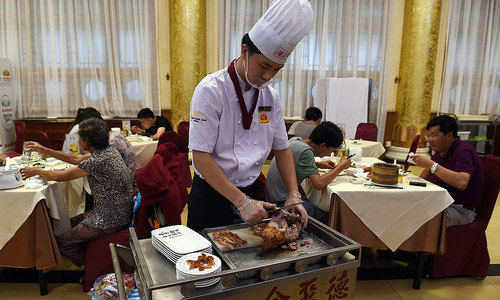 Why did the Peking Duck cross the country?
