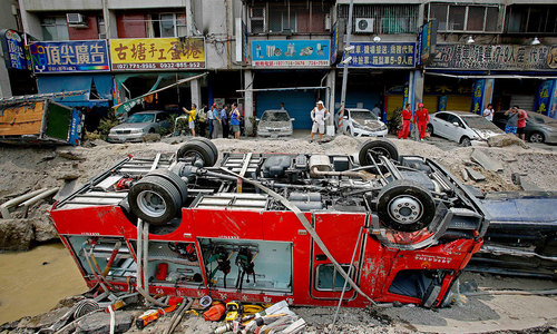 Taiwan gas explosions rip open roads, kill 24