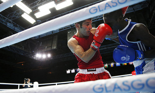 Waseem survives knockdown to win sem-final bout