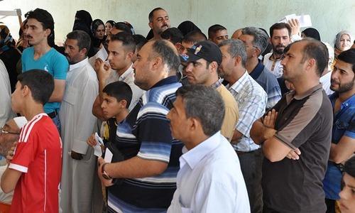 Iraq's Yazidi minority flees militant threat
