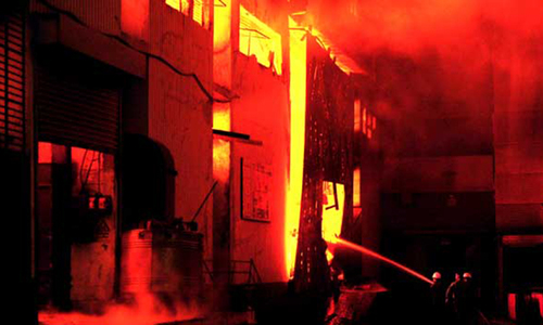 Families of 2012 factory fire victims struggle for compensation