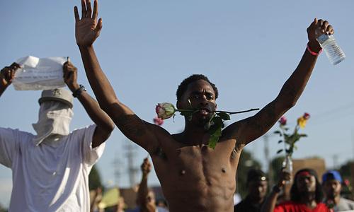 Ferguson police arrest 47 as peaceful protest degenerates