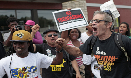 Police seize guns as racial clash worsens in Ferguson
