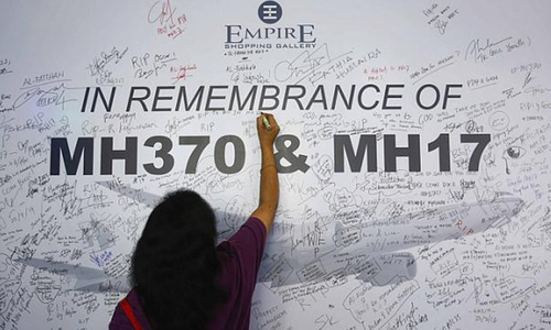 Two charged in Malaysia with stealing from accounts of missing flight victims