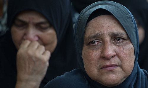 In somber homecoming, Malaysia lays MH17 dead to rest