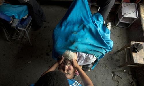 China targets Uighurs with beards, burqas