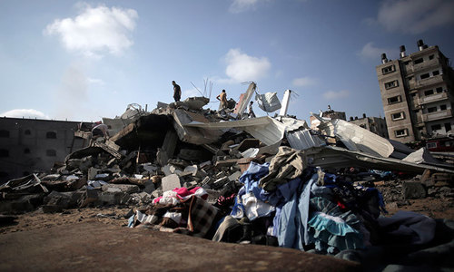 Israel hits Gaza highrises as sides weigh truce deal