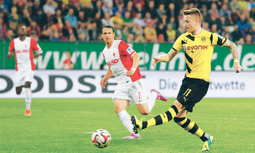 Reus sparkles as Dortmund claim first Bundesliga win