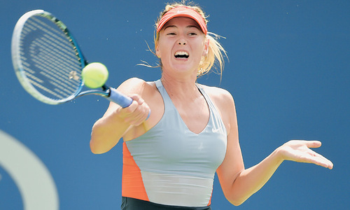 Wozniacki outlasts Sharapova as Federer marches on
