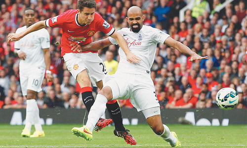 United crush QPR for first Premier League win