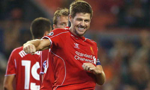 Gerrard rescues Liverpool as Arsenal suffer