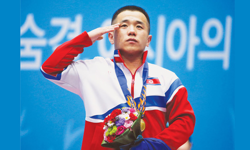 North Korean lifter betters own record as South set medal pace
