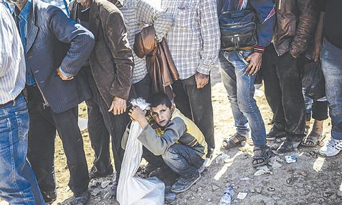 IS beheads seven men, three women