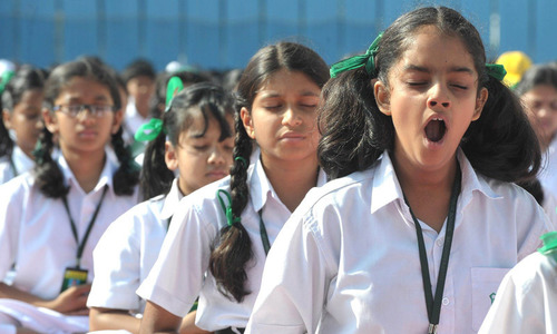 Indian school children perform yoga for world peace