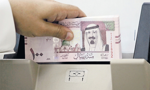 Saudi's biggest bank succumbs to pressure from Islamic scholars