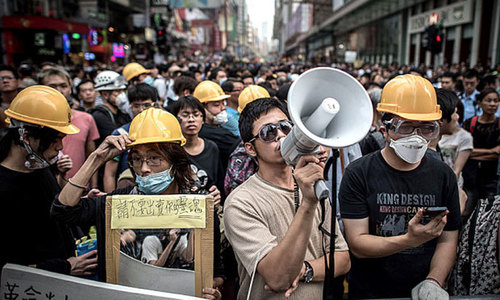 Protesters march on Hong Kong leader's residence